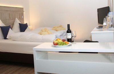 Bett und Wein in der Junior Suite