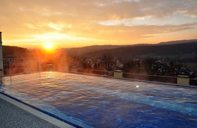 Sonnenuntergang im Dachpool