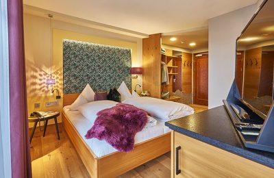 Bett im Komfortdoppelzimmer Lotus