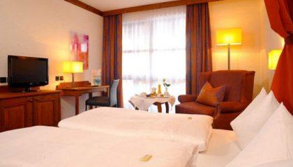 Bett im Doppelzimmer Kategorie II