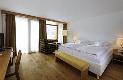 Bett im Doppelzimmer Deluxe