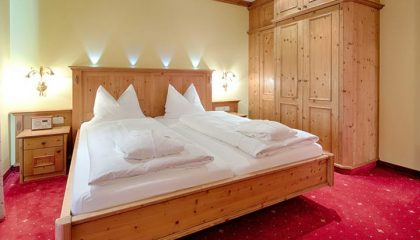 Bett im Böhmerwaldzimmer